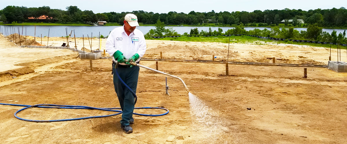 Pro-Tek Pest Control Expert Pre-Trreating Soil at Construction Site